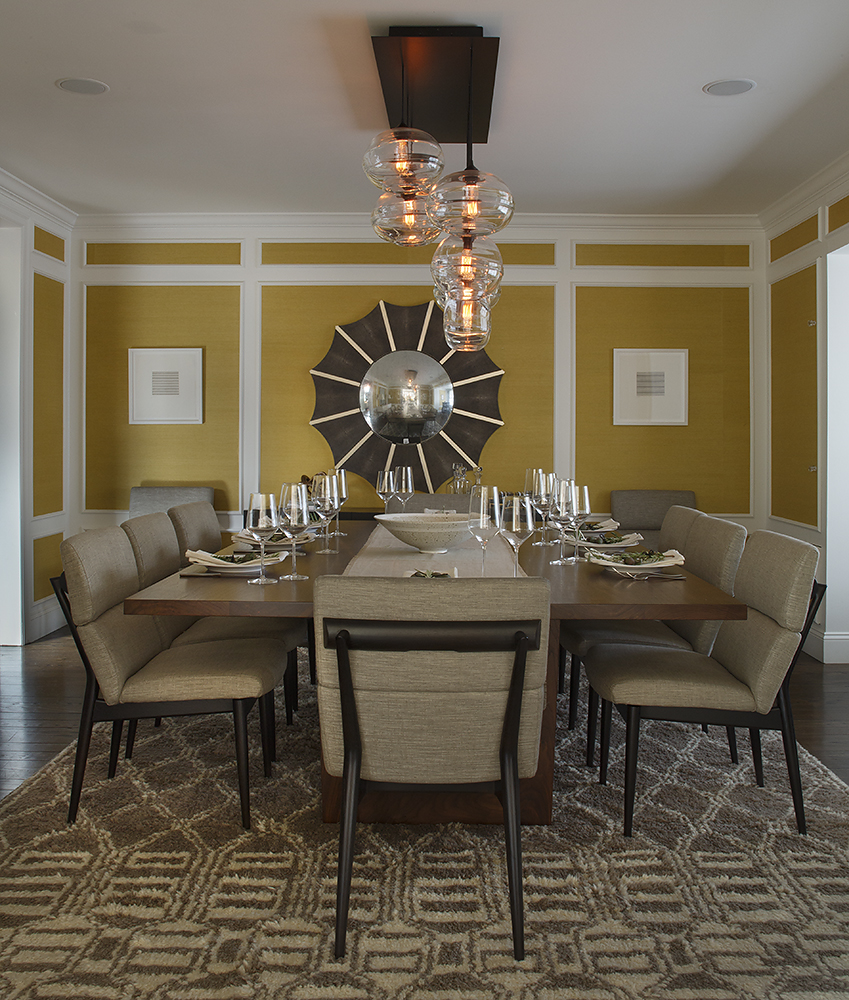 Statement making mustard yellow sea grass is tempered with richly hued, mid-century inspired furnishings.