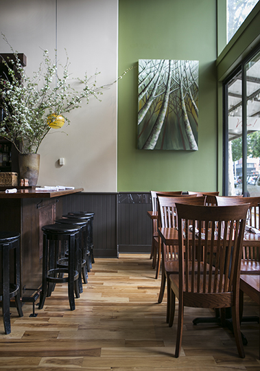 Oakland's Wood Tavern with interior design by Laura Martin Bovard Interiors. Window and bar seating.