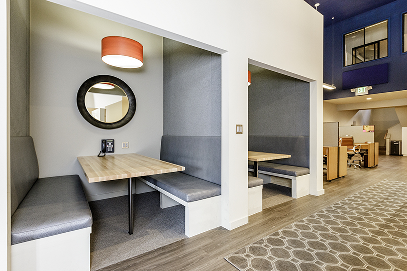 Booth seating in real estate office on Solano Avenue