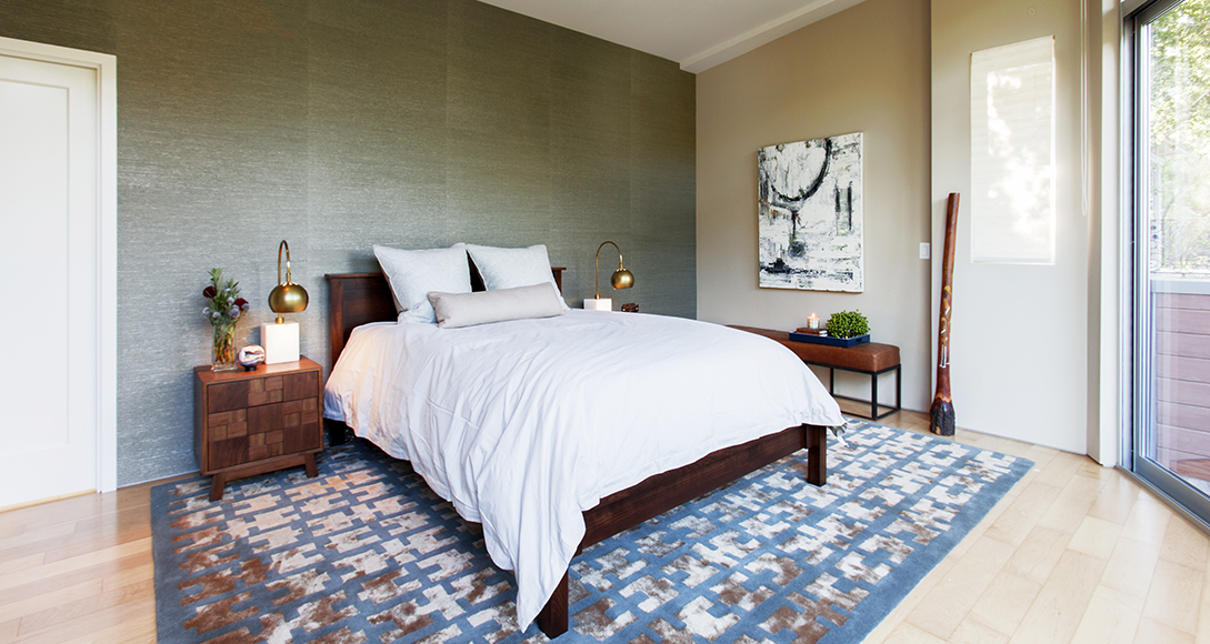 Sea grass wall treatment tamed an expansive wall in a masculine master suite.