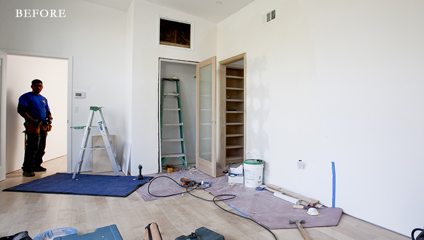 Before: Vaulted ceilings and large, uncovered walls needed taming.