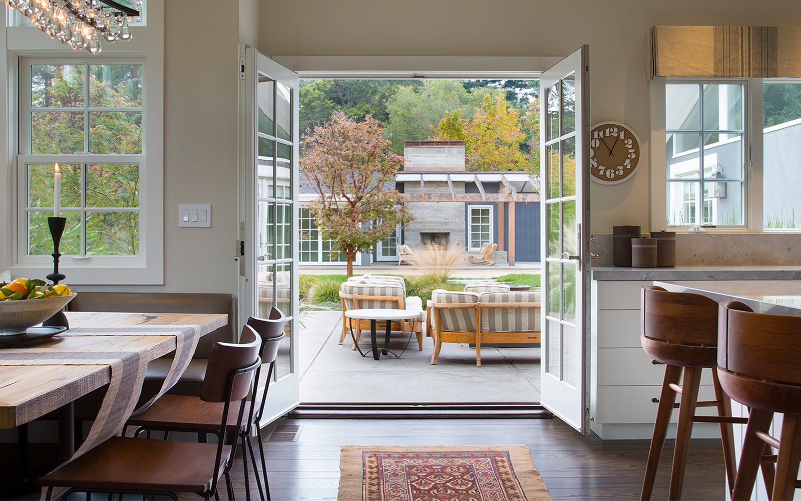 Newly installed French doors open kitchen to outdoor patio.