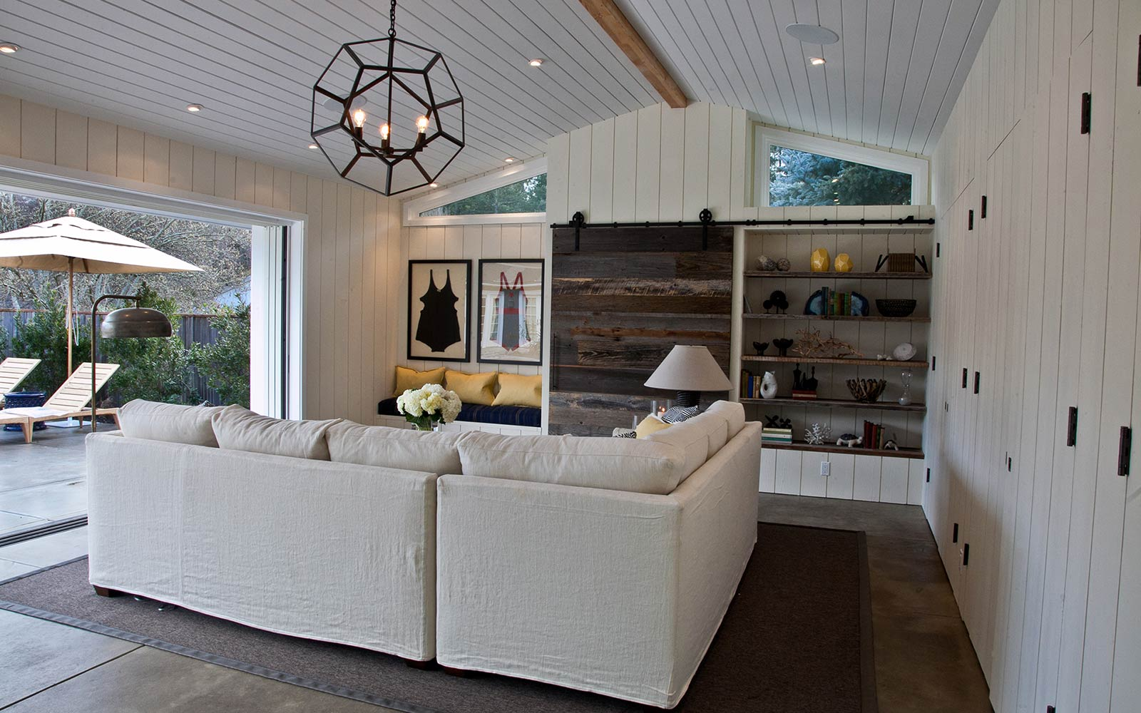 Contemporary pool house by Tiburon wealth interior designer.