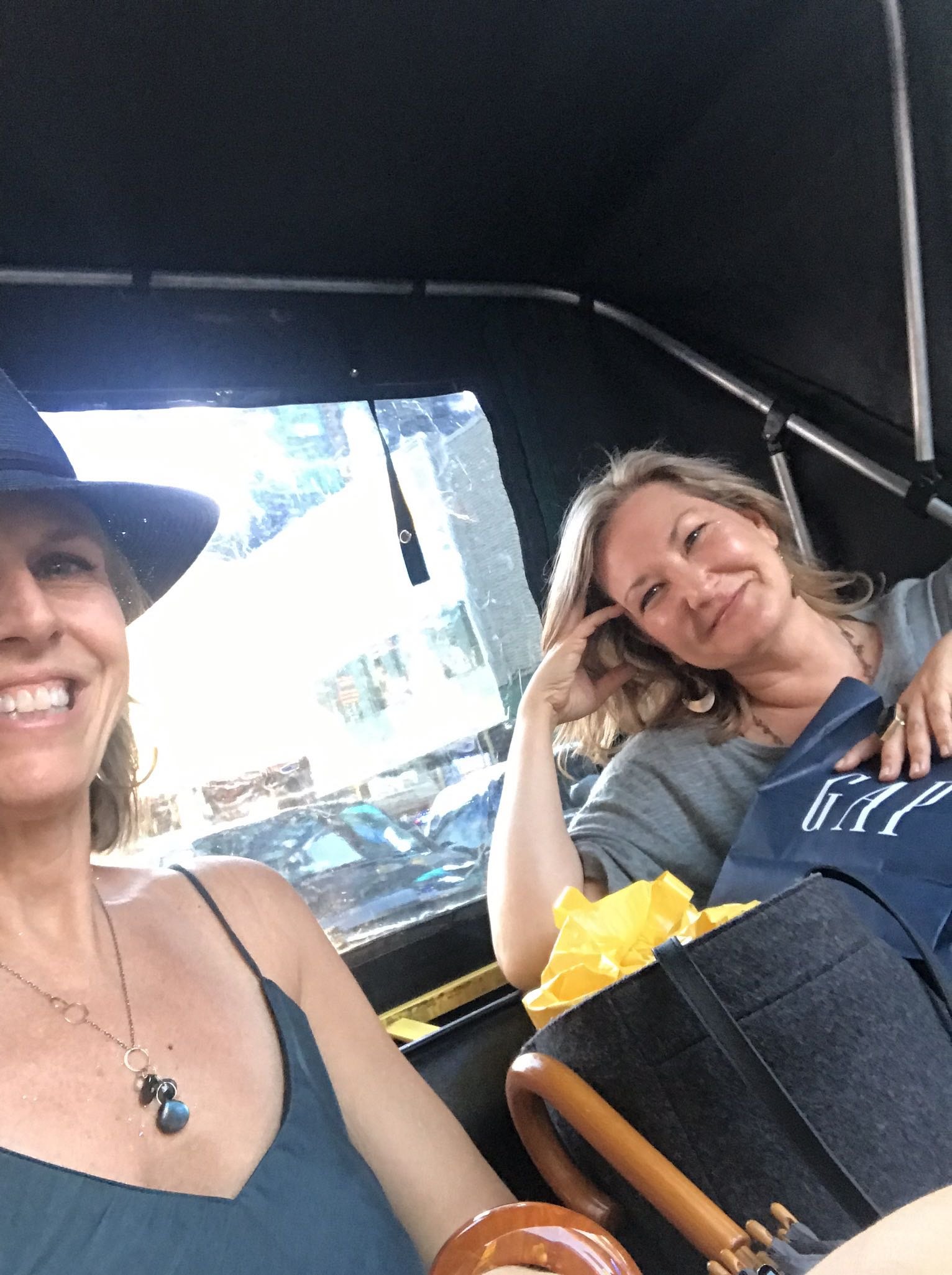 Good friends riding in a pedicab in New York City