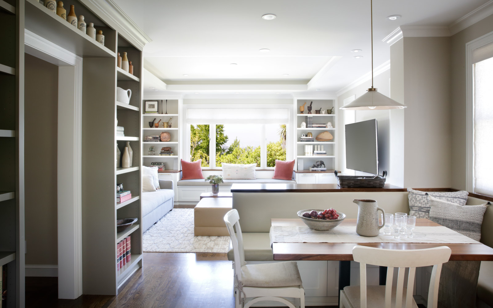 View of dining room and living room from kitchen, custom shelving collection displays, modern family design by Laura Martin Bovard Interior Design Firm, Piedmont / Oakland